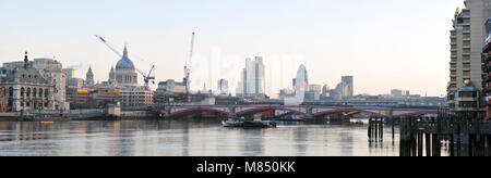 Panoramic view overlooking the river thames with st. pauls cathedral the gherkin and other buildings with cranes - Stock Photo