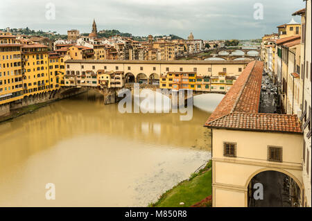 Bridge Ponte Vecchio in Florence (Italy) on a cloudy day in autumn - Stock Photo