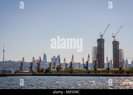 Overview of Baku with flame towers and oil pumps, Azerbaijan - Stock Photo
