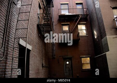 A city alleyway outside brick apartment building