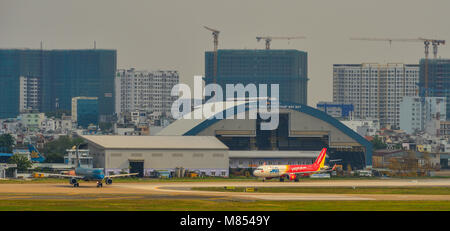 Saigon, Vietnam - Mar 11, 2018. Civil aircrafts at Tan Son Nhat Airport in Saigon (Ho Chi Minh City), Vietnam. - Stock Photo