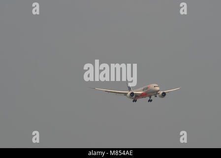 Saigon, Vietnam - Mar 11, 2018. An aircraft of Jetstar Pacific landing at Tan Son Nhat Airport in Saigon (Ho Chi - Stock Photo