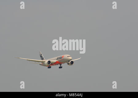 Saigon, Vietnam - Mar 11, 2018. An aircraft of Jetstar Pacific landing at Tan Son Nhat Airport in Saigon (Ho Chi - Stock Photo