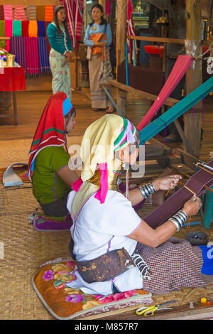 Padaung ladies, long neck ladies, weaving in Ywama Village, Shan State, Inle Lake,  Myanmar (Burma), Asia in February - Stock Photo