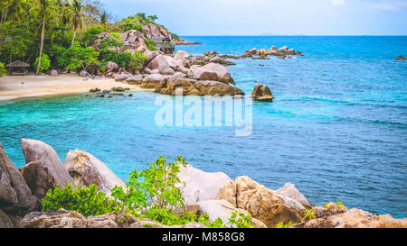 Costline of Koh Tao Islands in Thailand. Granite Rocks and blue lagoon with clear sea water - Stock Photo