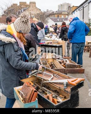 People at lane sale table auction, Ramsey Cornish auctioneers, Jane Street, Leith, Edinburgh, Scotland, UK, with - Stock Photo