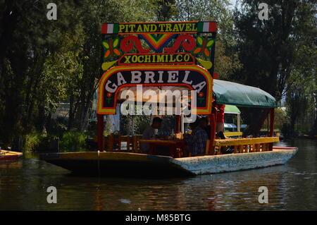 A trajinera in Xochimilco, Mexico City - Stock Photo
