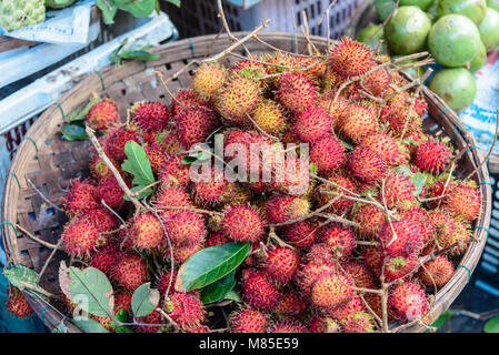 Lychees for sale at an outdoor market, Hoi An, Vietnam - Stock Photo