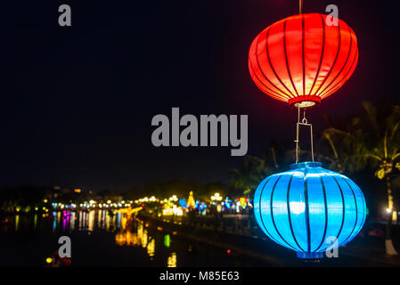 A red and blue lantern lampshade hanging outside in Hoi An, Vietnam - Stock Photo