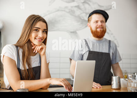 Coffee Business Concept - Portrait of small business partners working together at their coffee shop  - Stock Photo