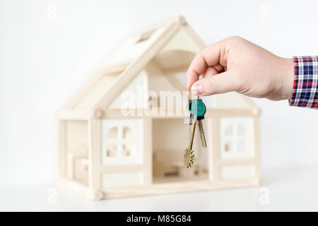 Businessman's hand giving key from new house.  Real estate for rent.  Big deal offer. Special proposition and easy - Stock Photo