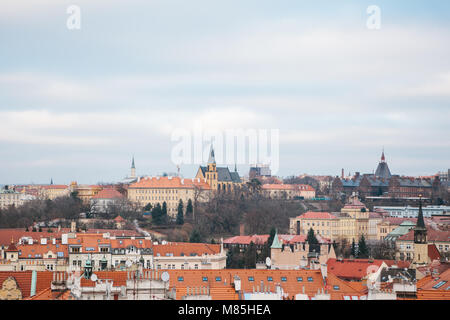 View from a high point. A beautiful view from above on the streets and roofs of houses in Prague. Traditional ancient - Stock Photo