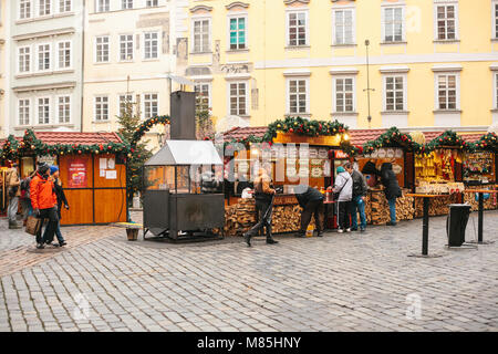 Prague, December 13, 2016: Old Town Square in Prague on Christmas Day. Christmas market in the main square. Celebrating - Stock Photo