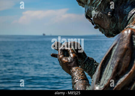 Le Sartine bronze sculpture in Trieste, one of the symbols of the city, representing two girls knitting on the waterfront - Stock Photo