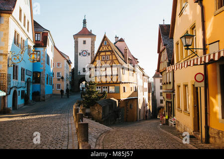 A beautiful street in Rothenburg ob der Tauber with beautiful houses in German style during the Christmas holidays. - Stock Photo