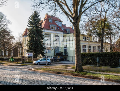 Berlin, Zehlenfdorf. Large Residence. Historic traditional house .Yellow exterior with arched windows & red tile - Stock Photo