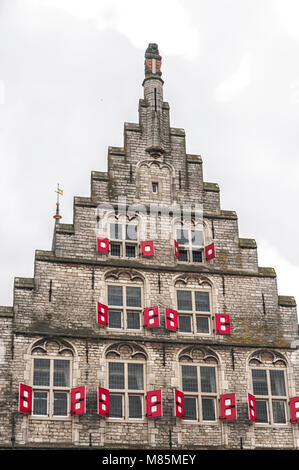 a beautiful view of a facade of a Dutch town hall - Stock Photo