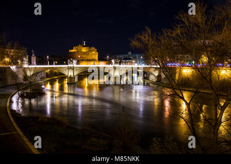 Landscape of the Castel Sant'Angelo fortress and the Vittorio Emanuele II bridge over the Tiber river. - Stock Photo