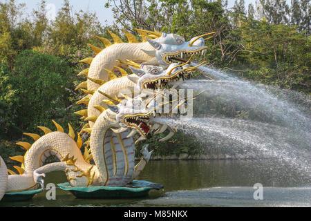 Dragon fountains on lake in ancient city near Bangkok - Stock Photo