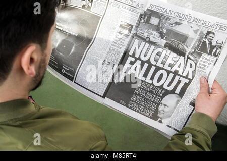 Paris, France. 14th Mar, 2018. PARIS, FRANCE - MARCH 14, 2018: A man reading The Sun newspaper. Dominique Boutin/TASS - Stock Photo