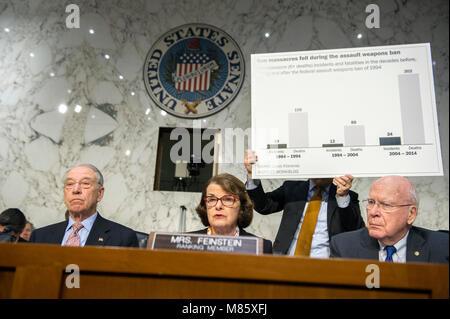 Washington, USA. 14th march, 2018. United States Senator Dianne Feinstein (Democrat of California), center, uses - Stock Photo