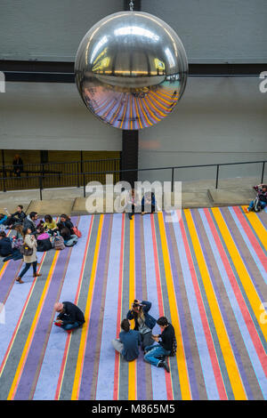 London, UK. 15th March, 2018. A huge reflective metal ball swings in the Turbine Hall of the Tate Modern, part of - Stock Photo