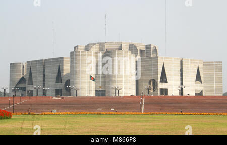 Dhaka. 15th Mar, 2018. The Bangladeshi national flag is seen flown at half-mast outside the parliament building - Stock Photo
