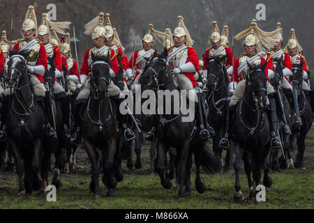 London, UK. 15th March, 2018. The ride past - The Household Cavalry Mounted Regiment, the Queen's mounted bodyguard - Stock Photo