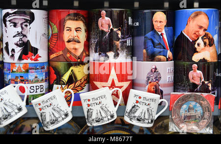 15 March 2018, Russia, St. Petersburg: Coffee mugs with the portraits of (left to right) Lenin, Stalin and Russian - Stock Photo