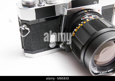Old 35 mm camera isolated on white close up - Stock Photo