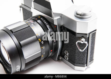 Old  Konica 35 mm camera isolated on white close up - Stock Photo