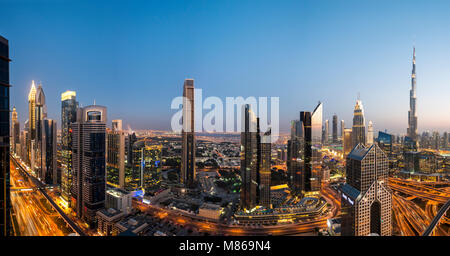 Cityscapes by day and night, featuring Singapore or Dubai.  For Singapore, featuring Marina Bay Sands by the Harbour. - Stock Photo