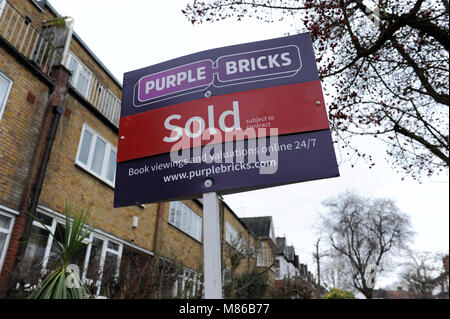 A Purple Bricks sold estate agent sign outside a house in Muswell Hill, London - Stock Photo