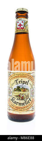 Winneconne, WI - 7 March 2018: A bottle of Tripel Karmeliet beer on an isolated background. - Stock Photo