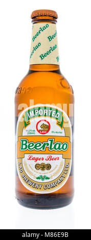Winneconne, WI - 7 March 2018: A bottle or Beerlao beer on an isolated background. - Stock Photo