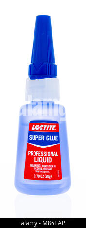 Winneconne, WI - 9 March 2018: A bottle of Loctite super glue on an isolated background. - Stock Photo