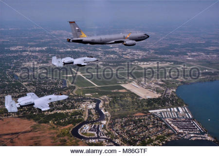 A Boeing KC-135 Stratotanker and two Fairchild Republic A-10 Thunderbolt IIs (Warthog) from the 127th Wing fly over - Stock Photo