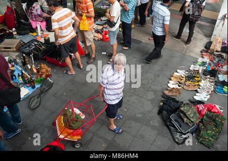 11.03.2018, Singapore, Republic of Singapore, Asia - People are bustling at a flea market adjacent to the Kreta - Stock Photo