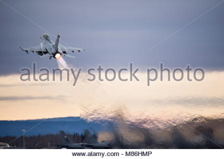 A Republic of Korea Air Force F-16 Fighting Falcon fighter aircraft takes off for a sortie from Eielson Air Force - Stock Photo