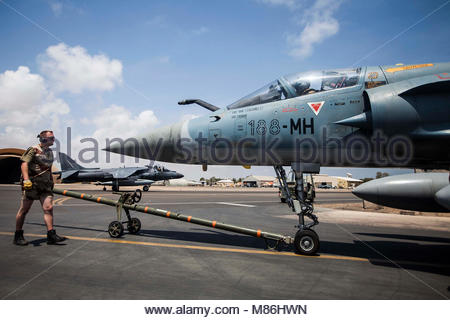 A French air force Mirage 2000 fighter jet with Fighter Squadron 03/011 Corsica is stowed at French Airbase 188 - Stock Photo