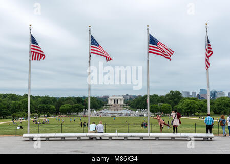 Lincoln Memorial and American flags viewed from the base of the Washington Monument in Washington DC, capital city - Stock Photo