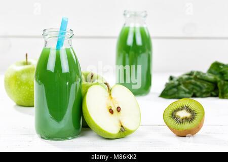 Green smoothie juice apple kiwi spinach fruit fruits fresh - Stock Photo