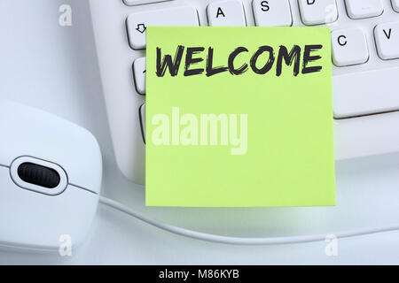 Welcome new employee colleague refugees refugee immigrants computer business concept mouse desk keyboard - Stock Photo