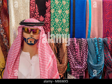 Traditional Clothing sold on the souk, Deira, Dubai, United Arab Emirates - Stock Photo
