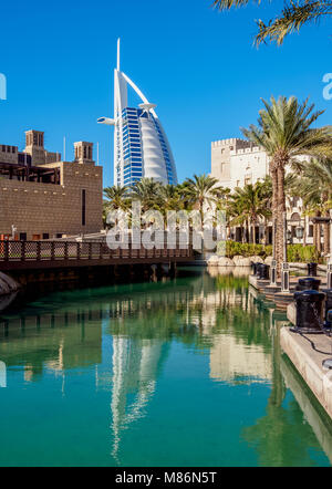 Medinat Jumeirah and Burj Al Arab Luxury Hotel, Dubai, United Arab Emirates - Stock Photo