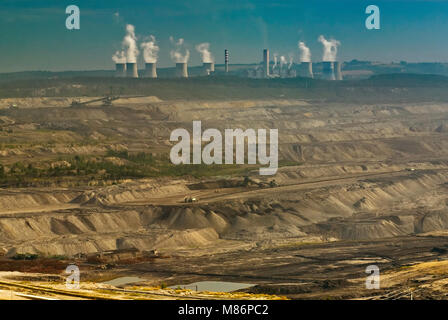 Cooling towers and chimney stacks at Turow thermal power plant over open-pit brown coal mine near Bogatynia in Lower - Stock Photo