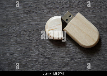 Usb flash drive with wooden surface on desk for USB port plug-in computer laptop for transfer data and backup business - Stock Photo