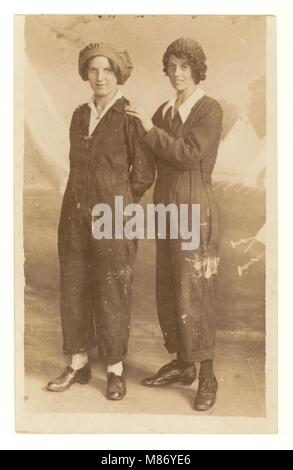 WW1 era (the Great War) postcard of 2 attractive happy women 'munitionettes' possibly factory or munitions workers - Stock Photo