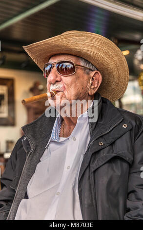 Portrait of a senior Cuban man with a cigar in his mouth, Calle Ocho, Miami, Florida, USA. - Stock Photo