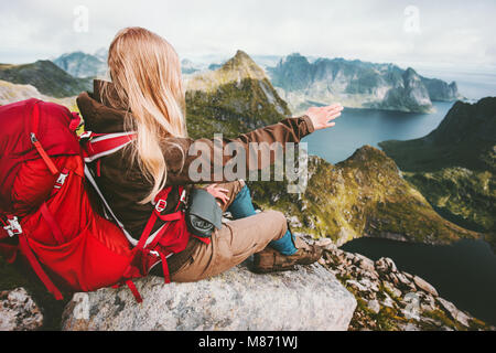 Traveler woman admiring landscape of mountains Norway Traveling lifestyle adventure concept hiking active summer - Stock Photo